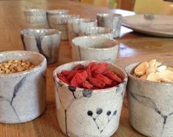 A set of 6 hand-made-hand painted ceramic espresso cups