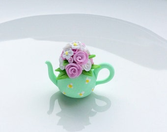 Miniature green teapot with flower bouquet for 1:12 scale dollhouse made from polymer clay