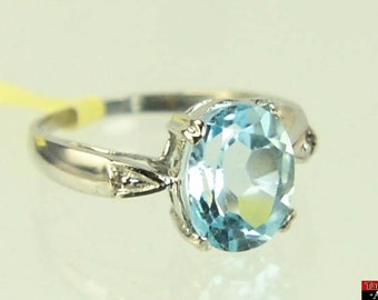 10K White Gold 3.57ct Oval Icy Blue Topaz .02ctw Round Diamond Sz 6 Ring L9Y