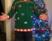 Knitting pattern Arthur Christmas Sweater in adult sizes.