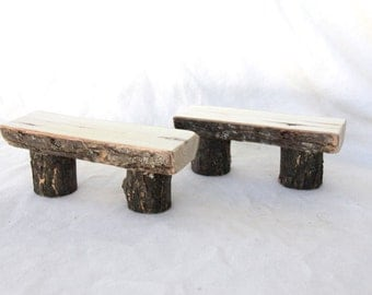 a pair of little wood fairy benches