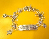 In Bloom: All STERLING Silver Artisan Embossed Floral Plaque Foci w/9 Flower Charms/Links & Flower Toggle Clasp CHARM Bracelet OOAK