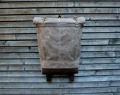 Waxed canvas rucksack/backpack with roll up top and  leather shoulderstrap,handle and leather bottem COLLECTION UNISEX