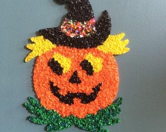 Vintage kitsch Halloween decoration melted plastic popcorn pumpkin jack o lantern
