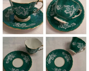 Aynsley Cup & Saucer Featuring A Teal, Embossed Body Adorned With Raised White Roses And Buds circa 1950's  DS