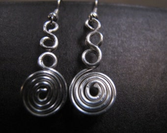 Funky silver wire wrapped earrings spirals and triple loops