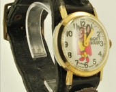 Mighty Mouse by Terrjtoons vintage wrist watch, 1 Jewel movement, round yellow base metal & stainless steel case, black leather cuff band
