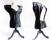 ultra glam backless black leather sweetheart top . blade runner-esque 1980's does the '40s . size small medium