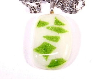 White with green inclusion glass pendant.