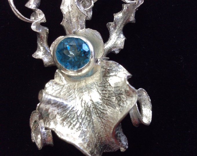 Sterling silver orchid pendant with Blue Topaz Center Stone
