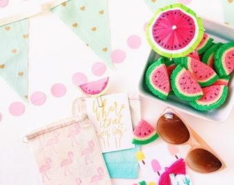 Shop this pic! Party garlands in both fabric and paper and flamingo stamped cloth bags perfect for party treats