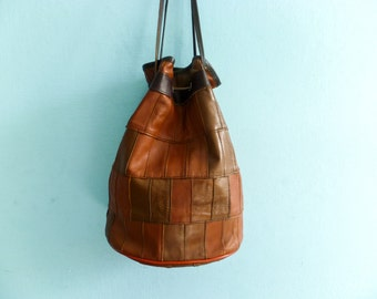 Vintage drawstring bag purse leather pouch / patchwork / brown / hobo / 1980s 80s