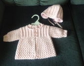 Crocheted baby sweater and matching hat
