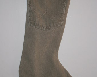 Christmas Stocking made fromTan Wrangler Jeans with country cotton print of animals cuff with a teal lining,