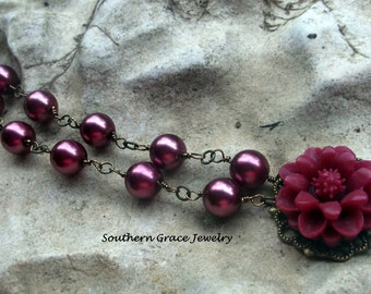 Raspberry glass pearl necklace with flower pendant