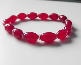 Red dyed quartz gemstone stretch bracelet with silver tone daisy spacers