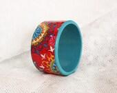 Wooden decoupage cuff with folk motif. Oriental colorful bagle bracelet. Red, blue & yellow.