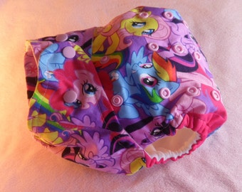 SassyCloth one size pocket diaper with My little Pony toss cotton print. Made to order.