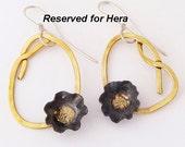 Tiny black poppy earrings.  Poppy in a knot