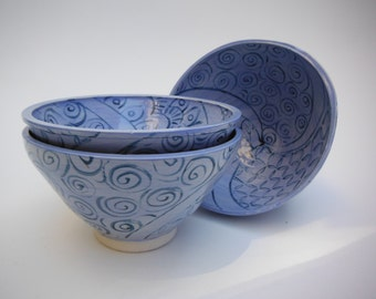Set of three handmade and handpainted decorative and functional ceramic bowls