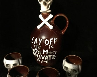 Antique Poison Skull Whisky Jug Decanter Set with Skull Shot Glasses Skull and Crossbones Pottery at Gothic Rose Antiques
