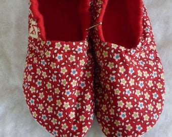 Red calico KozyFoots slippers in size women's large