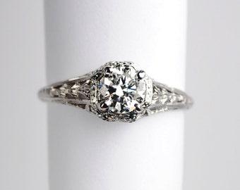 CHANGING STONE  A Very Feminine Art Deco .55 Carat Platinum Diamond ring
