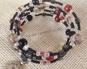 """Bohemian Chic Memory Wire Bracelet. Variety of bead styles. Reversible metal charm: """"Follow Your Heart"""", """"Love Life, Live Life"""""""