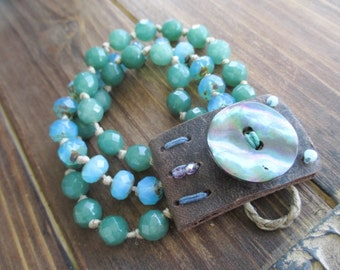 SALE Multi strand leather knotted bracelet - Castaway - iridescent abalone button green blue beach boho by slashKnots