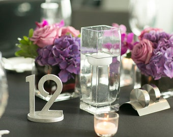 Wedding table decoration. Wedding signs. Table numbers.