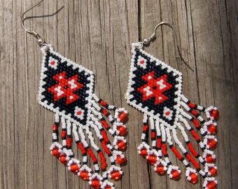 Native American style handmade beaded earrings in a native design