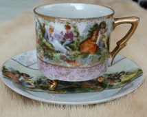 Tea Cup & Saucer Delicate Romanitc Courting Couples Lusterware Tri-Footed Gold Accents