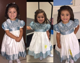 Girls custom FULLY smocked bodice, silk dupioni dress w/ruffle trimmed sleeves &peter pan collar. Free matching bow. Two colors of choice.