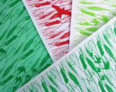 Handprinted paper in christmas colours
