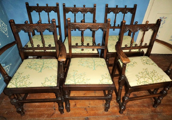 set of six medieval looking dining room chairs with tree