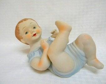 Piano baby boy figurine mid century vintage porcelain bisque