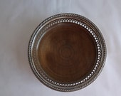 Extra large silver plate wine coaster with wooden base made by Gorham Silverplate, Cavalier pattern