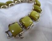 Green and gold Coro Pegasus bracelet / Vintage Green thermoset bracelet