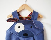 Blue puppy dog dungaree costume.