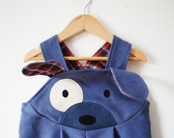 Blue puppy dog dungaree costume.