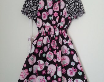 Gorgeous sweet Pink and blak butterfly peasant dress  size 5 available