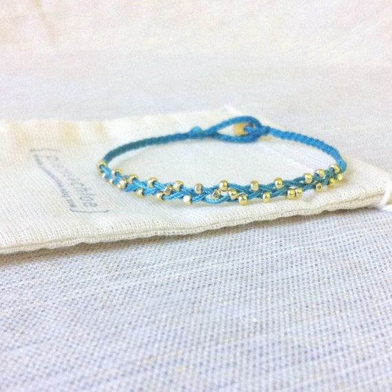 olivia. tiny gold nuggets everyday braided bracelet with bead clasp closure