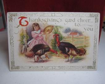 Vintage 1910's-20's unused embossed Thanksgiving greeting postcard little girl feeding turkeys on a farm