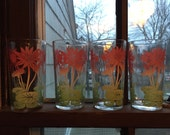 Four adorable floral and lily pad juice glasses
