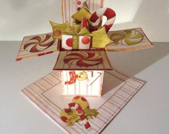 Handmade holly jolly Christmas popup card with matching envelope.