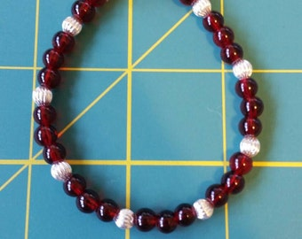 Simple, yet pretty red and silver bracelet.