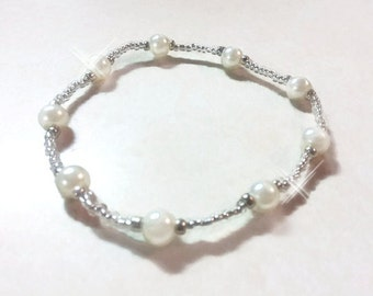 White glass pearl beaded stretch bracelet.  White pearls with toho seed beads