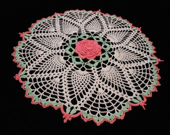 Pink center rose, pineapple doily