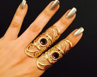 Filigree swirl cage rings set of 2 pcs. Gold color filigree metal, adorned with amethyst swarovsky crystals.