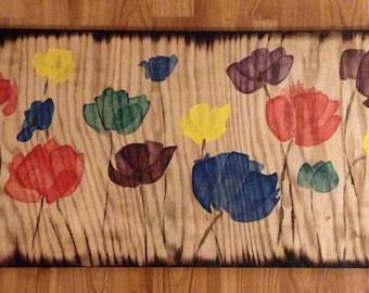 Rainbow Poppies on Reclaimed wood with Burned edges by Alaska artist Kim Sherry